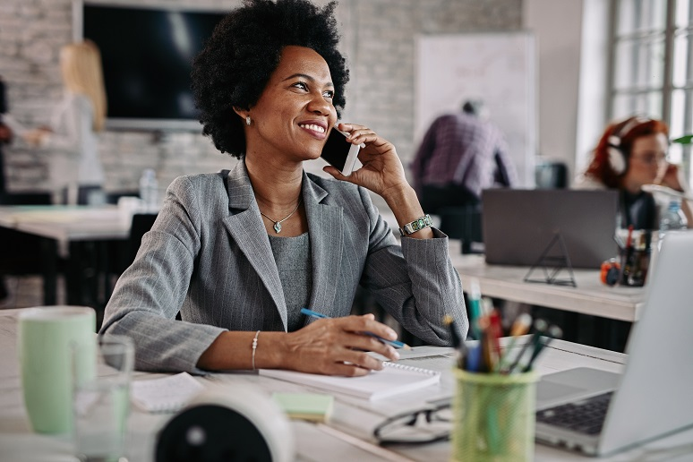 Smiling businesswoman on the phone