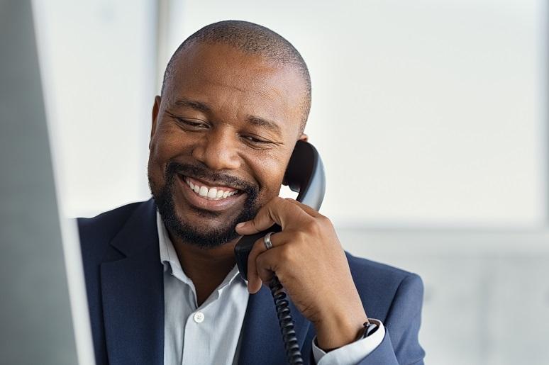 Photo of businessman using a deskphone