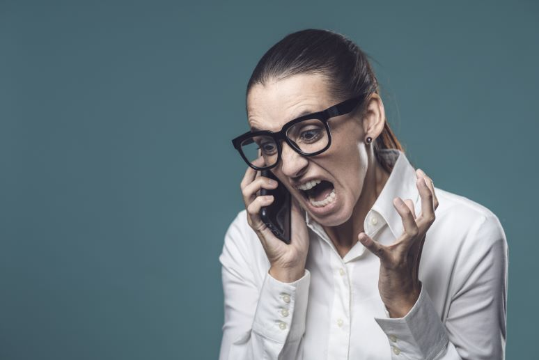 Women frustrated on phone