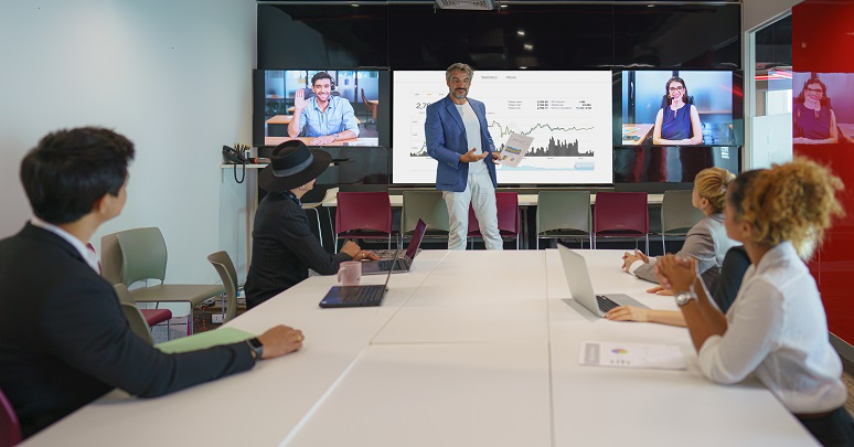 Photo of businesspeople having video meeting in conference room