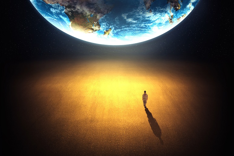 Man looking up at the planet