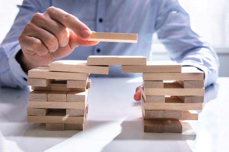 Photo showing building bridge out of blocks