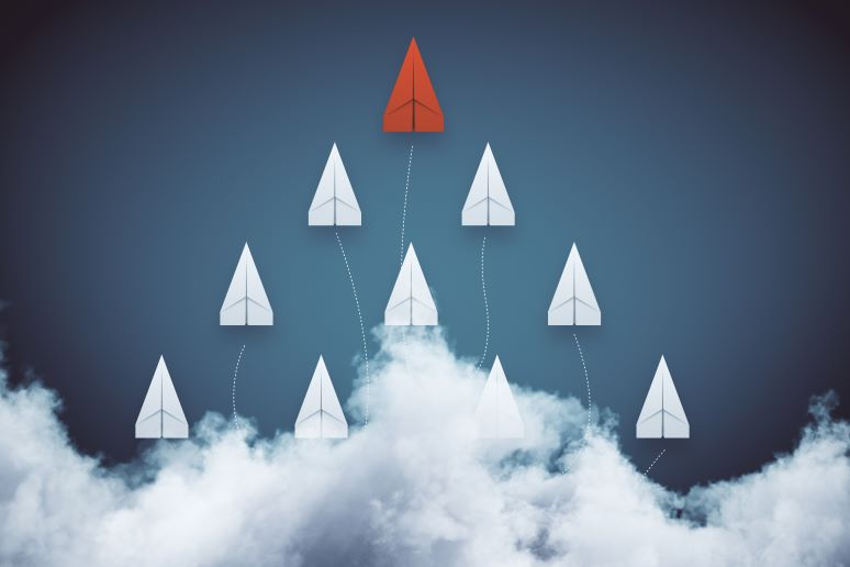Illustration of paper airplanes showing leadership