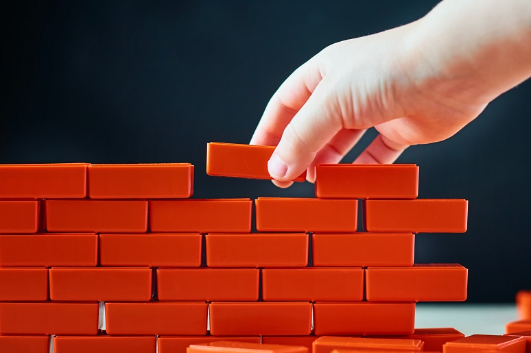 Picture of a brick wall being built