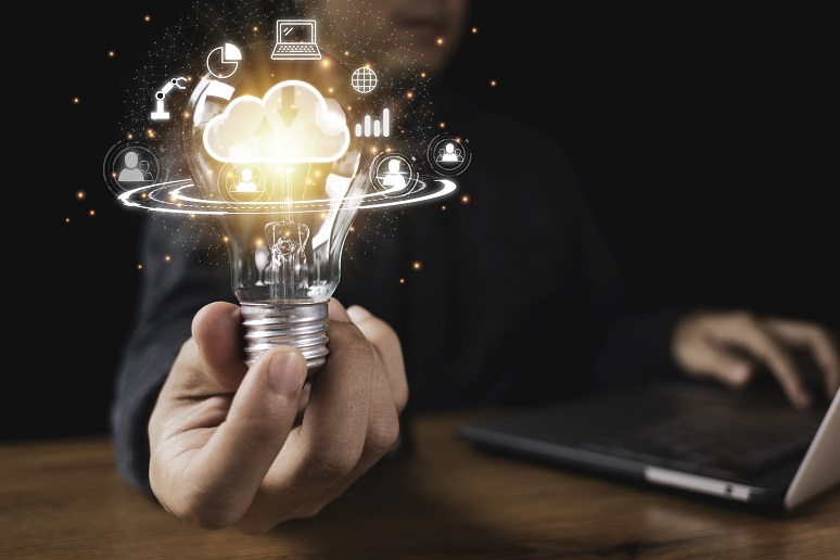 A business person holding a lightbulb