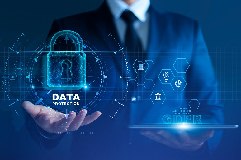 An image of a business man holding a data protection icon in one hand and GDPR in another