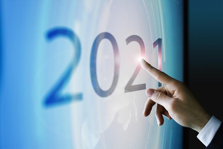 A person pressing a 2021 button