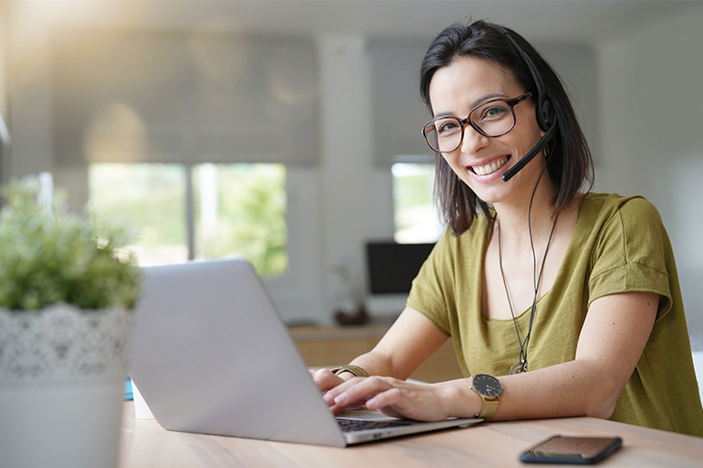 Photo showing contact center agent working from home