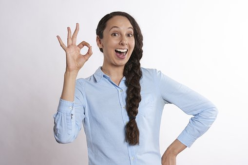 Girl signaling OK
