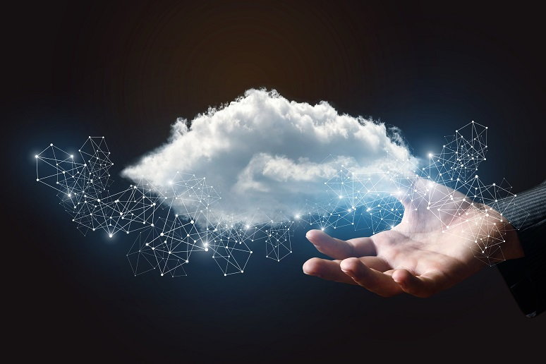 A business person holding a cloud