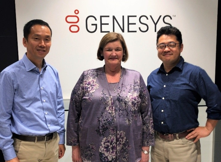 The blogger pictured with Genesys Japan execs