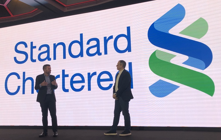 Standard Chartered's Stuart Beaumont on stage at Avaya event