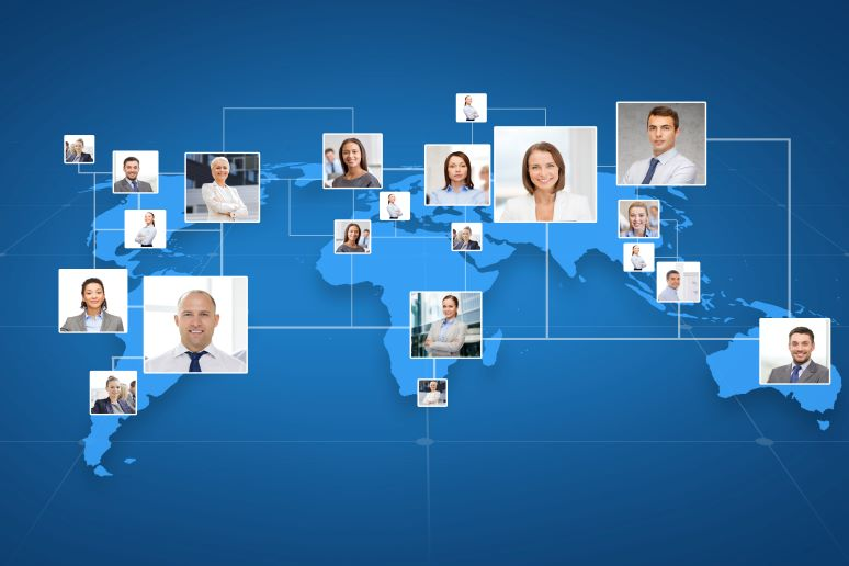 Picture of business colleagues over world map