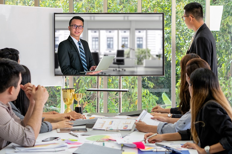Photo of videoconference among business colleagues