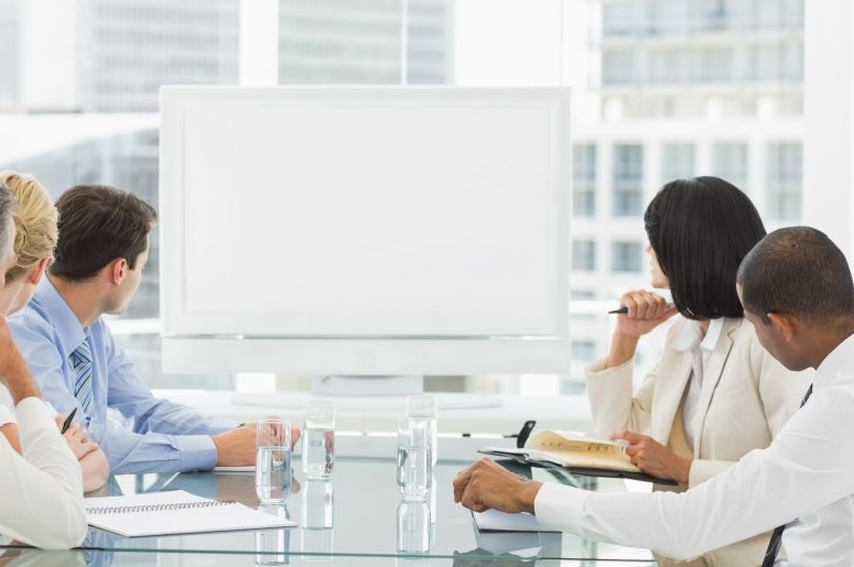 Business meeting with whiteboard