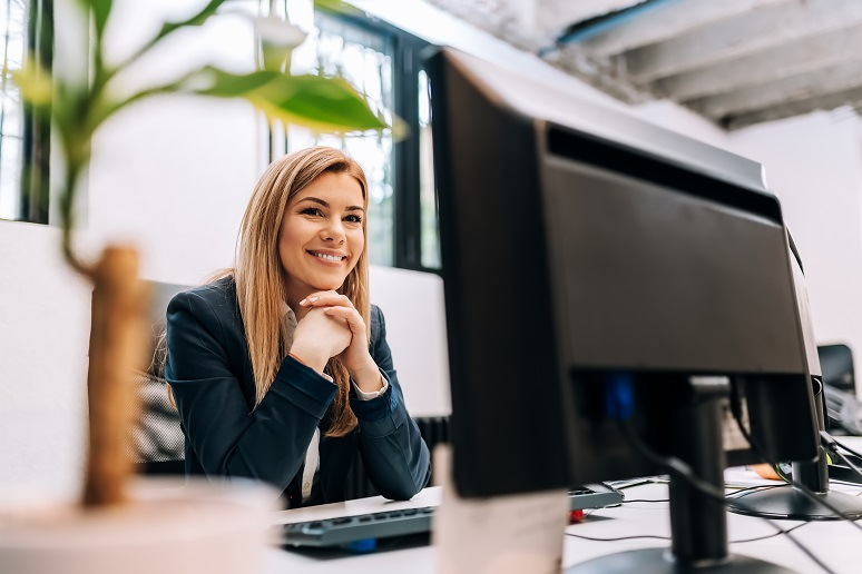 An employee happily working in the office