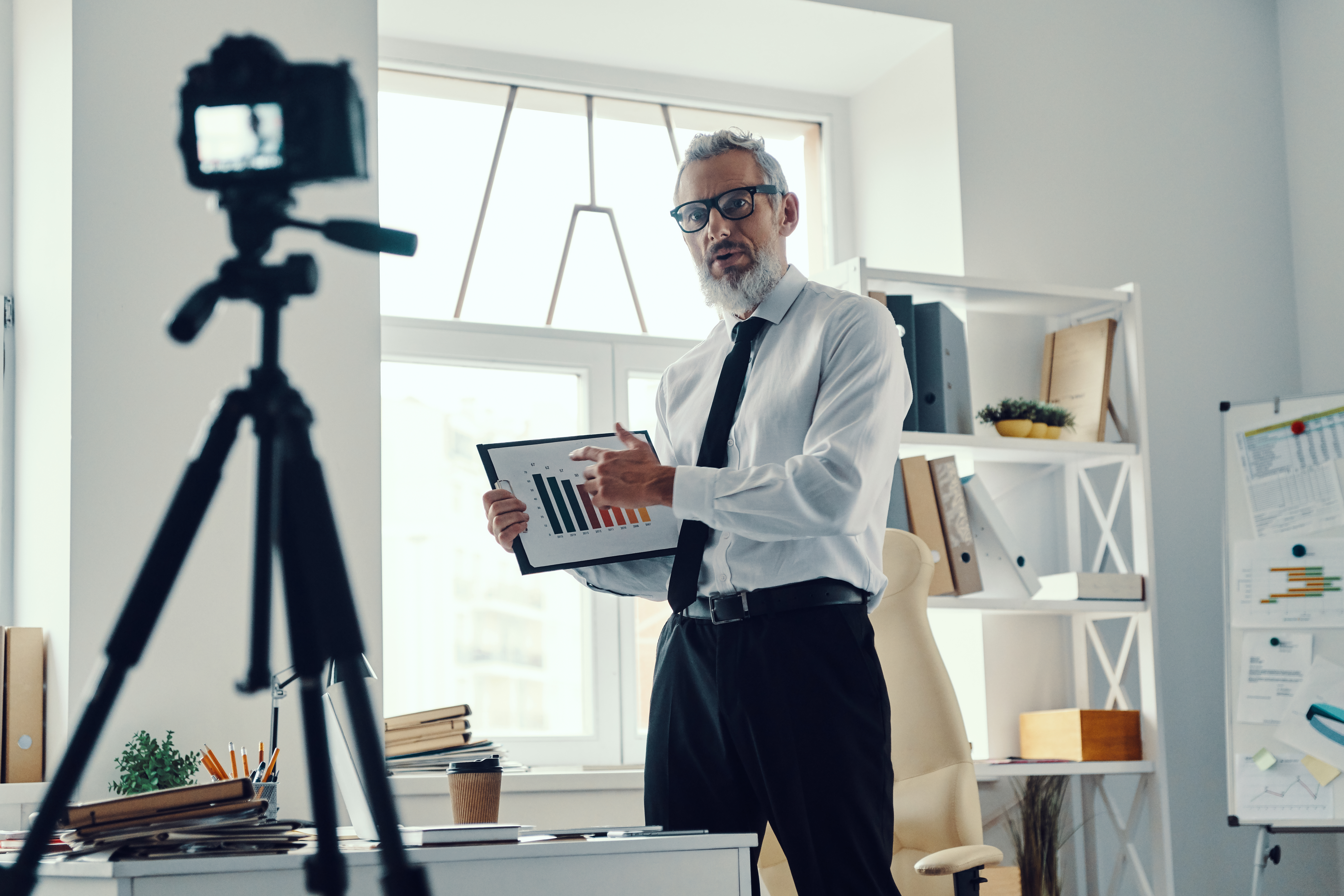 Photo of businessman doing video presentation