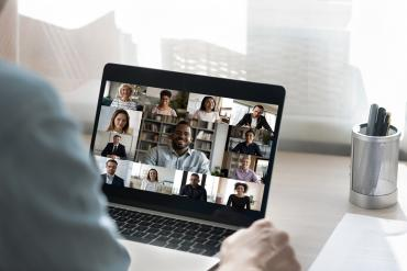 One in-office businessman meeting virtually with remote colleagues