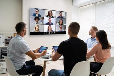 Hybrid in-office, remote collaborative video  meeting