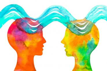 Two heads with waves between them showing empathy