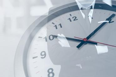 Businessman with time ticking down on stopwatch