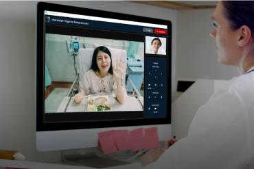 Photo of a telesitting patient and doctor session