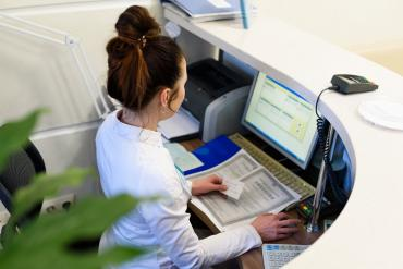 A receptionist working at desk