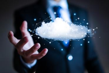 A business person with a cloud in hand
