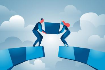 Illustration of two workers reaching across a divide