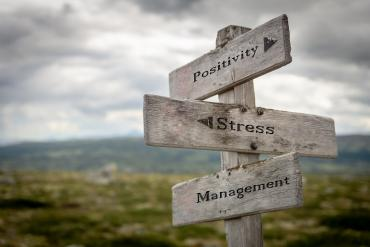 Road sign pointing to stress, management, positivity