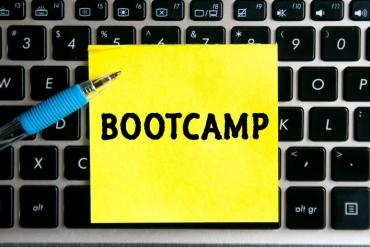 "Illustration of ""bootcamp"" sticky note on keyboard"