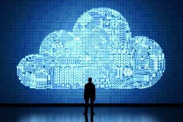 Man standing in front of cloud computing image