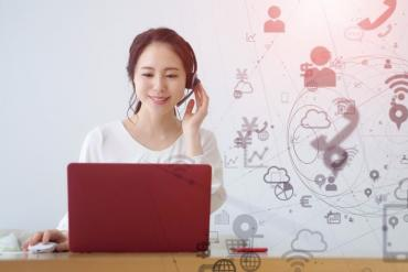 Photo of young women working remotely