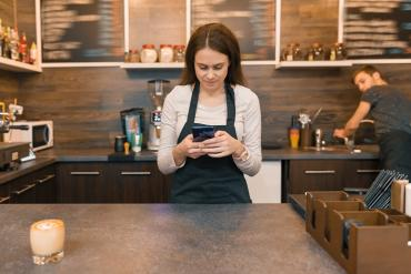 Picture of retail clerk using smartphone