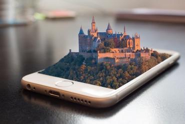 3D castle emerging through smartphone