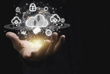 A hand holding a cloud of technologies