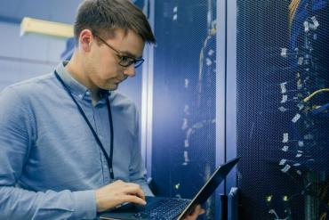 Picture of guy in data center with broadband connections