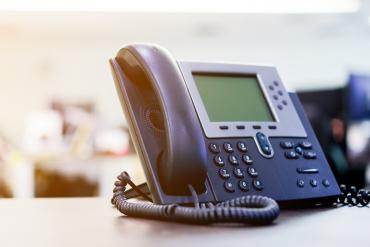 A phone on an office desk