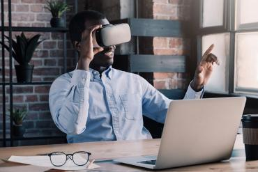A business man using VR