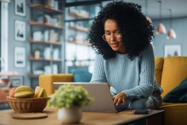 Young woman messaging on laptop