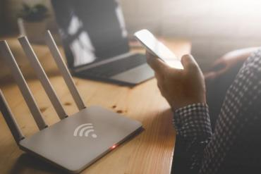 Image of remote worker with Wi-Fi router
