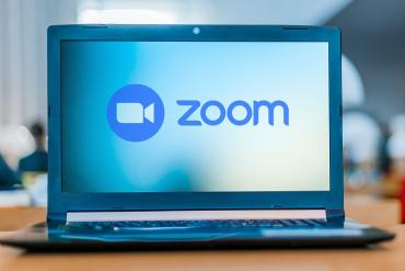 A laptop with Zoom on it