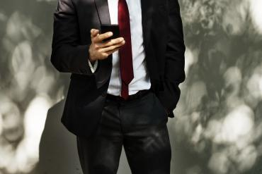 Business person looking at phone