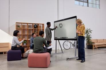 Workers collaborating with Cisco whiteboard