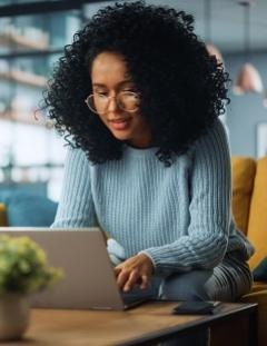 Young woman messaging via her computer
